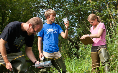 Luther students assist Professor Enos-Berlage in water collection and analysis.