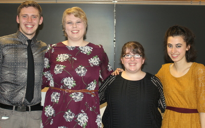 Four students present their senior paper projects: (from left to right) Maxwell Rooney, Cailin Higgins, Joy Gnade, and Evie Iralu.