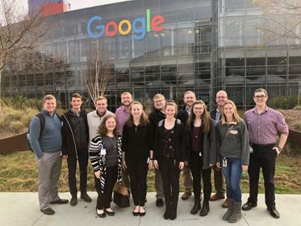 Students with Ellen Widerski, '16 (Front row, far right) in front of one of the four buildings of the Googleplex