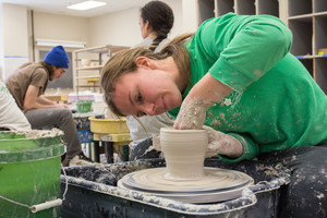 Luther students working in a pottery class.