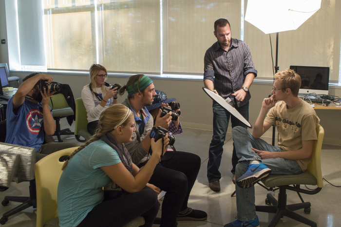 Luther students work with Professor Aaron Lurth for a photography class.
