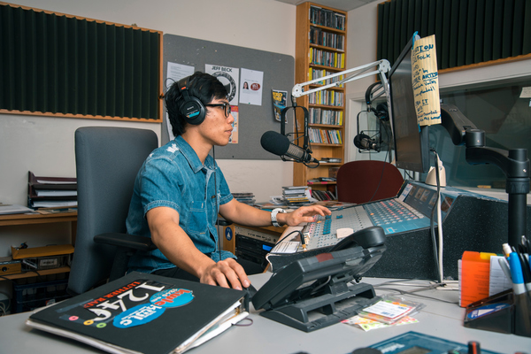 A Luther student works at KWLC, Luther's radio station, as part of a work study position.