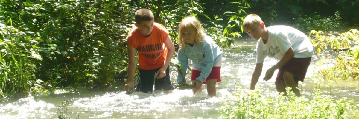 Children explore their local waterways.