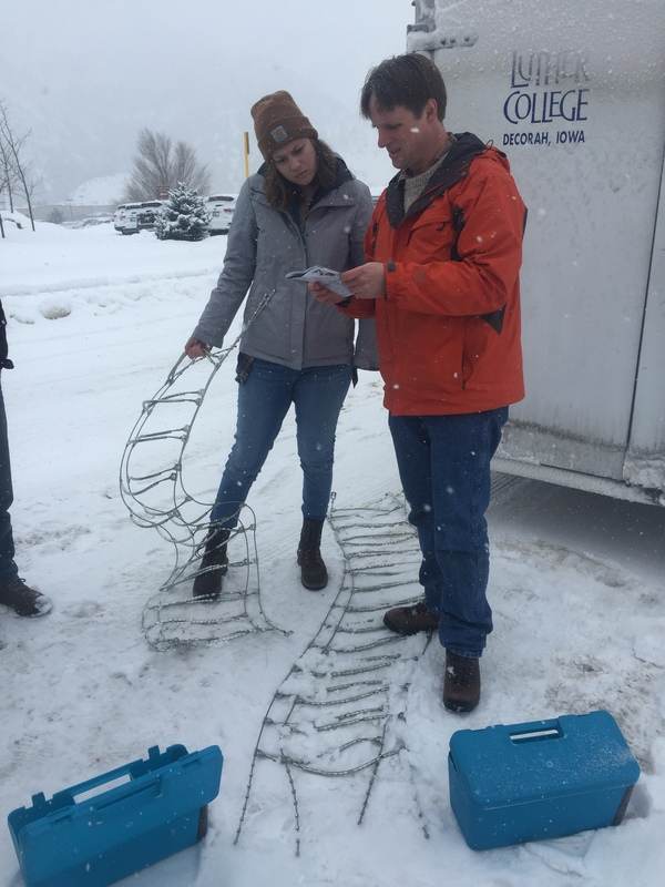 "Kate Reilly and Dr. Baack putting chains on the vans.<a href=""/reason/images/667975_orig.jpg"" title=""High res"">∝</a>"