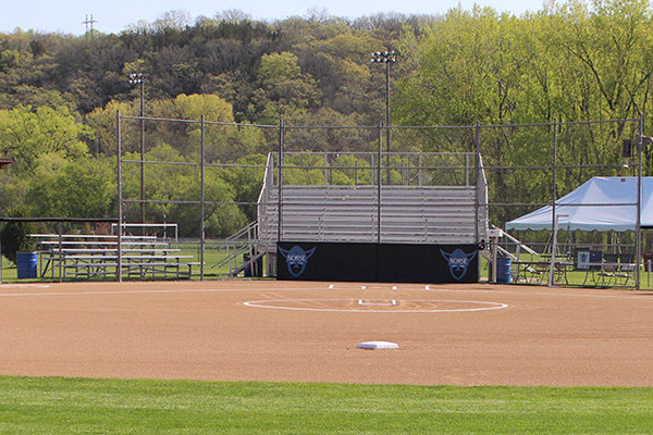 View of Luther softball field dugouts and bases.