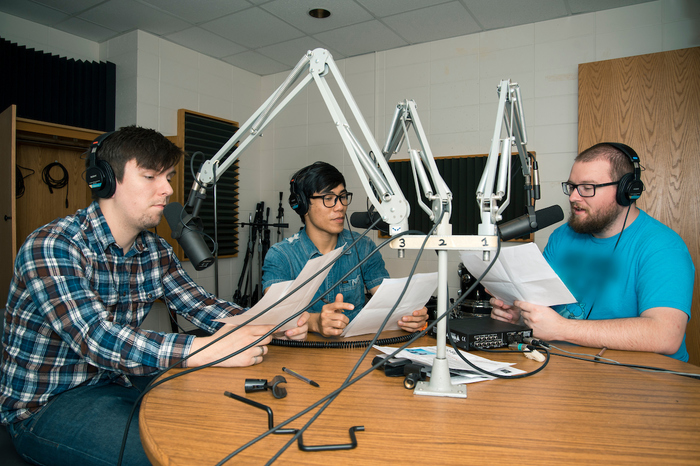 Three students works at KWLC, Luther's radio station, as part of their work study positions.