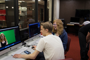 Two Luther students edit a video for a multimedia course.