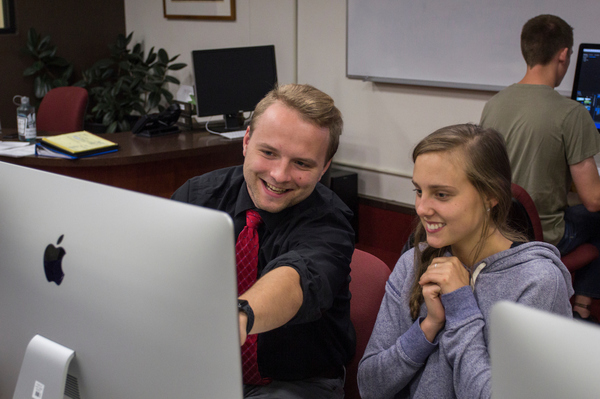 Two Luther students work together in a multimedia course.