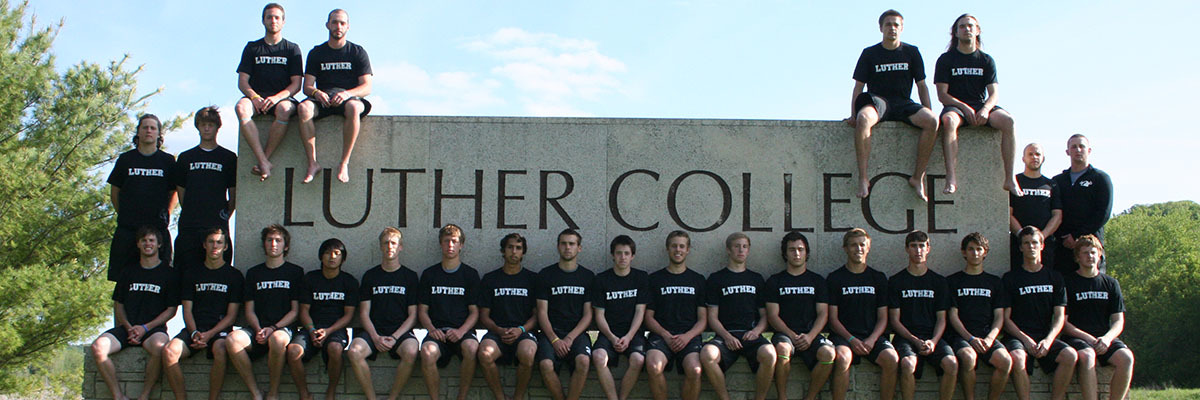Members of the 2012 LUFDA squad pose for a team picture around a Luther College sign.